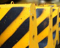 Black and Yellow Concrete Barriers Stock Photos