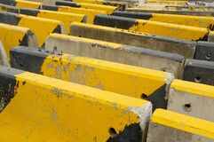 Black and yellow concrete road barriers or road blocks Royalty Free Stock Images