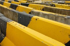 Black and yellow concrete road barriers or road blocks. Expressing endless barriers concept Royalty Free Stock Photo