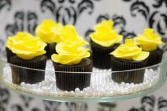 Black and yellow cupcakes Stock Photography