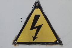 Black and yellow danger warning sign. Attention. Background Royalty Free Stock Photo