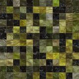 Black and yellow decorative small mosaic tiles background. This decorative mosaic tiles background is use in home decoration and swimming pool Stock Photo
