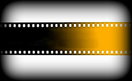 Black and yellow film strip on Grey background Royalty Free Stock Image