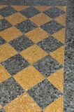 Black and yellow floor tiles in house Stock Images