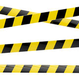 Black and yellow glossy barrier tapes  isolated Stock Image
