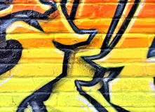 Black and yellow graffiti detail on a brick wall Royalty Free Stock Photos