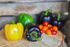 Black, yellow, green paprika`s and cherry tomatoes Stock Photos