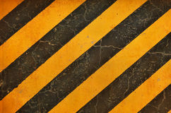 Black and yellow hazard lines with grunge effects Royalty Free Stock Photo
