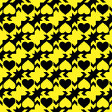 Black and yellow hearts. Background with seamless abstract pattern with hearts in yellow and black colour Stock Images