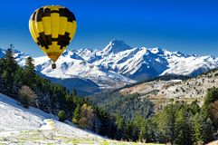 Black and yellow hot air balloon with Pic du Midi de Bigorre Py royalty free stock images