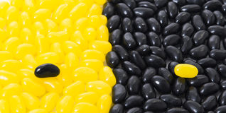 Black and yellow jelly beans Stock Images