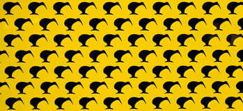 Black on Yellow Kiwis. Rows of kiwi shapes on a yellow background stock illustration