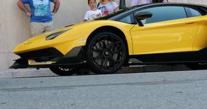 Black And Yellow Lamborghini SVJ - Side View. Monte-Carlo, Monaco - June 20, 2019: Black And Yellow Lamborghini Aventador SVJ Roadster Side View Parked In Front stock video