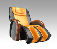 Black and yellow leather reclining massage chair. Stock Image