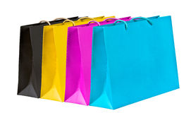 Black, yellow, magenta, cyan shopping bags. Stock Image
