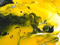 Black and yellow marble abstract hand painted background Stock Photos