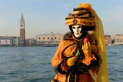 Black yellow masked woman Royalty Free Stock Photo