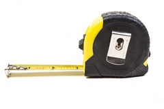 Black and yellow measuring tape. Isolated on white background Royalty Free Stock Photography