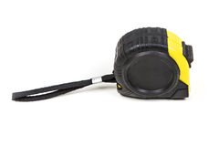 Black and yellow measuring tape. Isolated on white background Stock Image