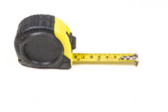 Black and yellow measuring tape. Isolated on white background Royalty Free Stock Images