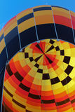 Black, yellow, orange hot air balloon Stock Photo