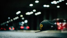 Black and Yellow P Cap Hanging in the Air Royalty Free Stock Images