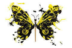 Black and yellow paint splash made butterfly Stock Photos