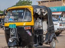 Black and yellow painted Tuctuc in a street of Dongola stock photos