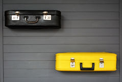Black and yellow retro suitcases on the wooden grey floor. Vintage travel suitcases. Concept: tourism, travel and migration. Flat lay Stock Images