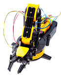 Black and yellow robotic arm Stock Images