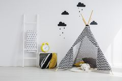 Black and yellow room. Black and yellow kid room with tipi stock photo