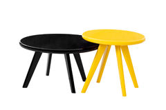 Black and yellow  round tables. On a white background Royalty Free Stock Photography