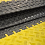 Black-yellow speed bumps. Humps royalty free stock photos