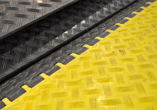 Black-yellow speed bumps Humps. The black-yellow speed bumps Humps stock photography