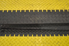 Black-yellow speed bumps Humps. The black-yellow speed bumps Humps royalty free stock photos