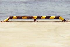Black and yellow strip balustrade at port promenade Stock Image