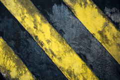 Black and yellow strips. Old black and yellow strips on the wall Stock Photography