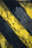 Black and yellow strips. Old black and yellow strips on the wall Royalty Free Stock Photography