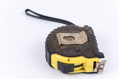 Black yellow tape measure isolated over white Stock Photo