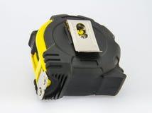 The black-yellow tape measure. Ment tool Stock Photo