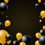 Black and yellow transparent helium balloons on dark background. Flying latex balloons. Royalty Free Stock Photography