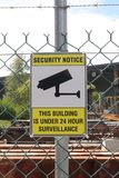 Black, yellow and white Security Notice, This Building Is Unde stock photography