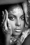 Black young beauty portrait woman with  golden makeup in bw Royalty Free Stock Image