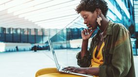 Black young female with the laptop stock photo