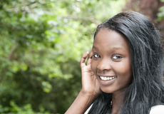 Black young girl smiling royalty free stock image