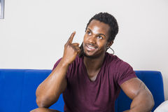 Black young man thinking an idea, doing funny expression Royalty Free Stock Images