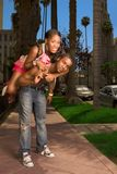Black young urban couple making fun in street Stock Image