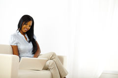 Black young woman browsing on laptop Royalty Free Stock Photography
