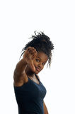 Black young woman gesturing. A black young woman gesturing with her hands Royalty Free Stock Photo