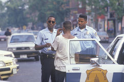 Black youth being arrested Royalty Free Stock Image